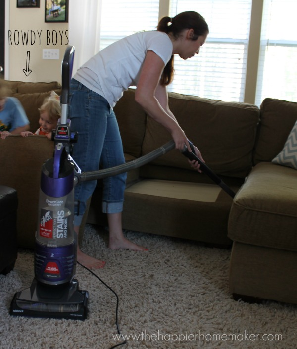 vacuuming under couch